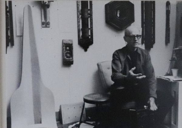 Norman Daly in his studio with Llhuroscian artifacts ~1970